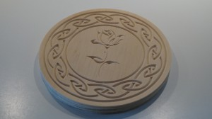 Coaster mad with v-bit carving.