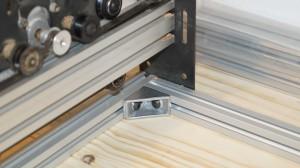 Corner assembled using extrusion bracket.